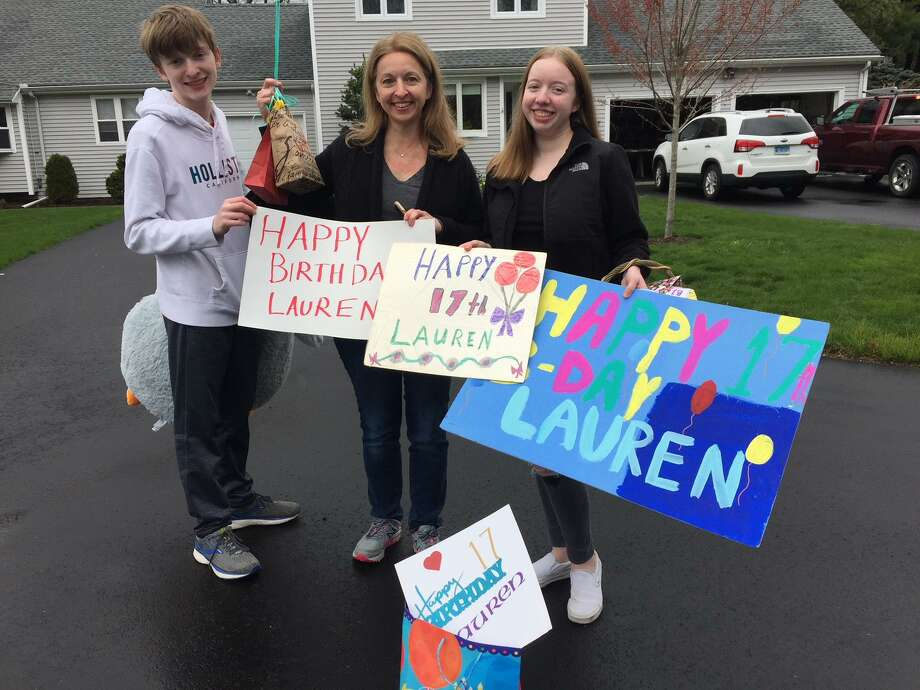 Lauren Baudo celebrated her 17th birthday with a caravan of vehicles, including the Huntington Fire Department hook and ladder truck. Lauren is pictured with her brother, Logan, and mother, Carla, center. Photo: Contributed Photo / Connecticut Post