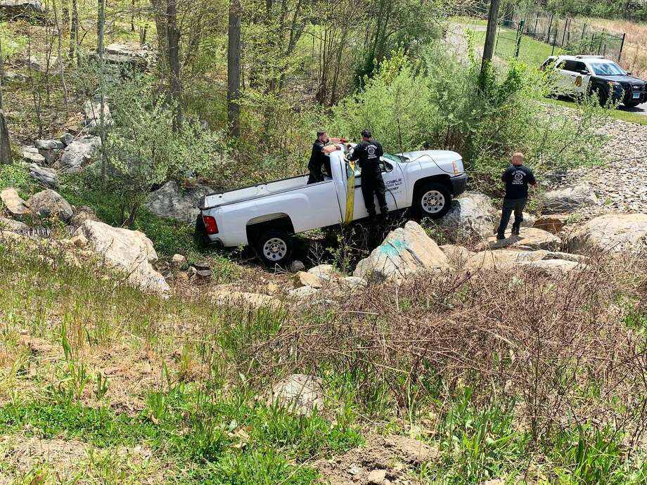 Shelton firefighters responded to a one-vehicle rollover Thursday, May 7, on Beard Saw Mill Road. No one was injured because no one was in the vehicle at the time, fire officials stated. Photo: Shelton Fire Department / Contributed Photo / Connecticut Post