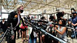 Salon owner Shelley Luther leans in to speak to the media after she was released from jail in Dallas, Thursday, May 7, 2020. Luther was jailed for refusing to keep her business closed amid concerns of the spread of COVID-19. (AP Photo/LM Otero)