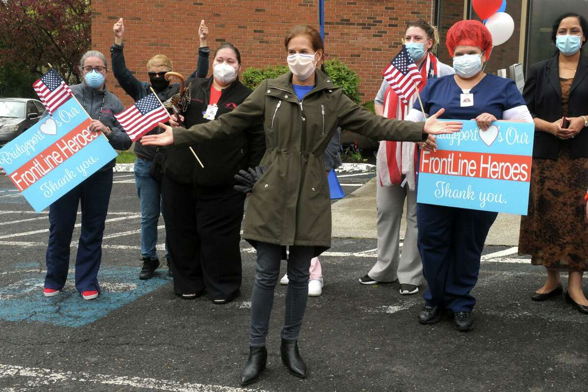 Lt. Gov. Susan Bysiewicz poses with staff members during a thank you rally in front a health care center this month.
