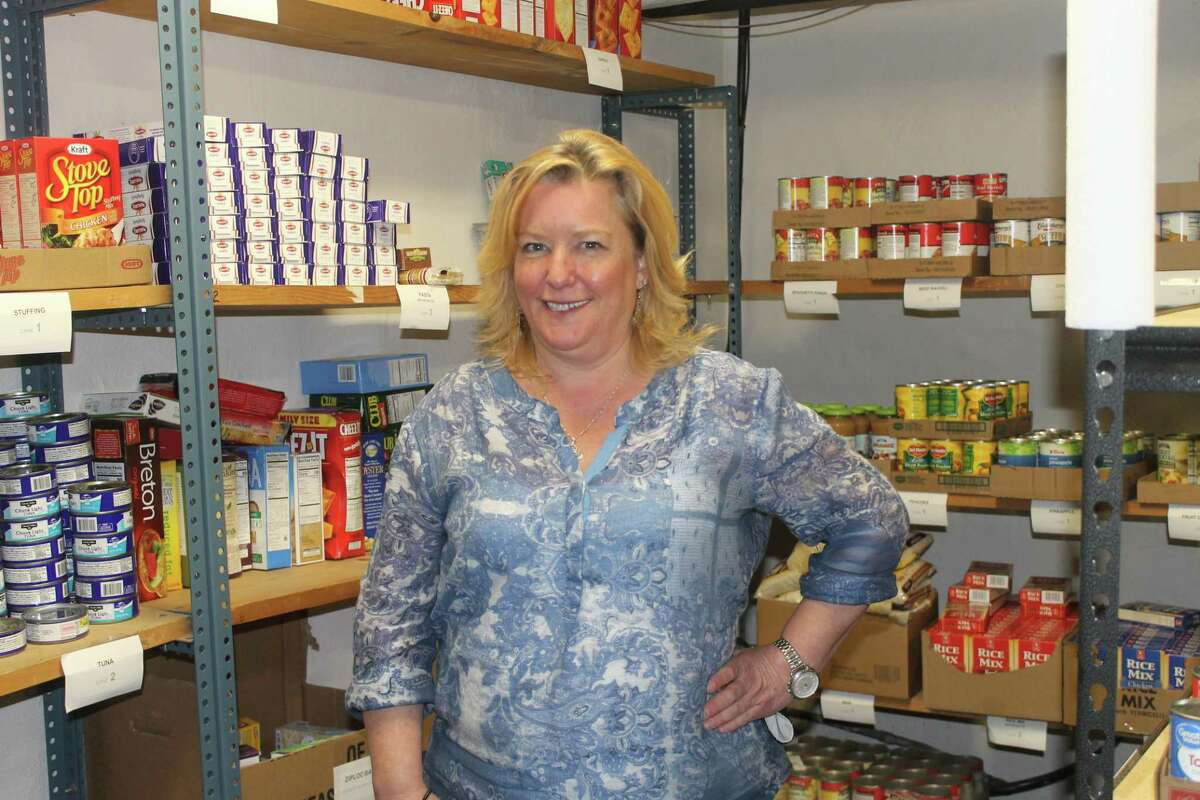 Ann O'Neill stands in the Chatham Area Silent Pantry in the basement of Tracy Memorial Village Hall, Chatham, N.Y., on May 5, 2020. (Abigail Rubel)