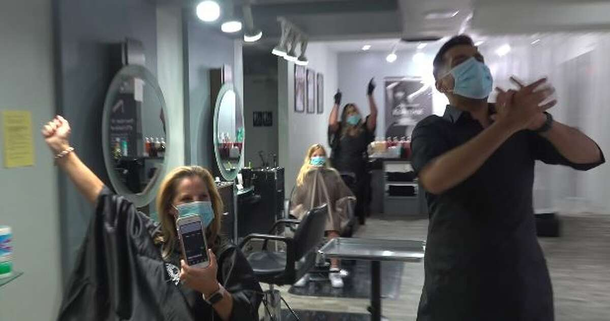 Neri Hair Studio in Pearland held a midnight countdown on Friday and officially reopened its doors with customers already waiting in salon chairs.