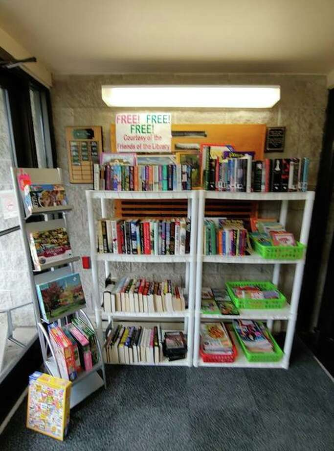The Free Litte Library selection includes books, puzzles, DVDs and activity books.