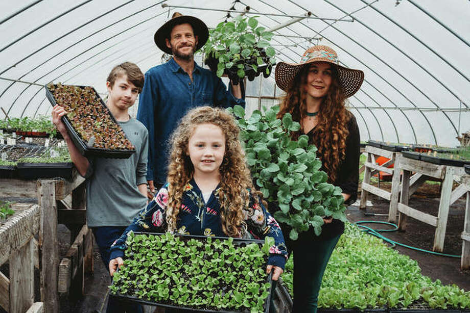 Gardener and author Crystal Stevens, right, with her husband and two children who work together on the family farm and business, FLOURISH, in Godfrey. Photo: Photos By Candice Pyle |The Telegraph