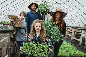 Gardener and author Crystal Stevens, right, with her husband and two children who work together on the family farm and business, FLOURISH, in Godfrey.