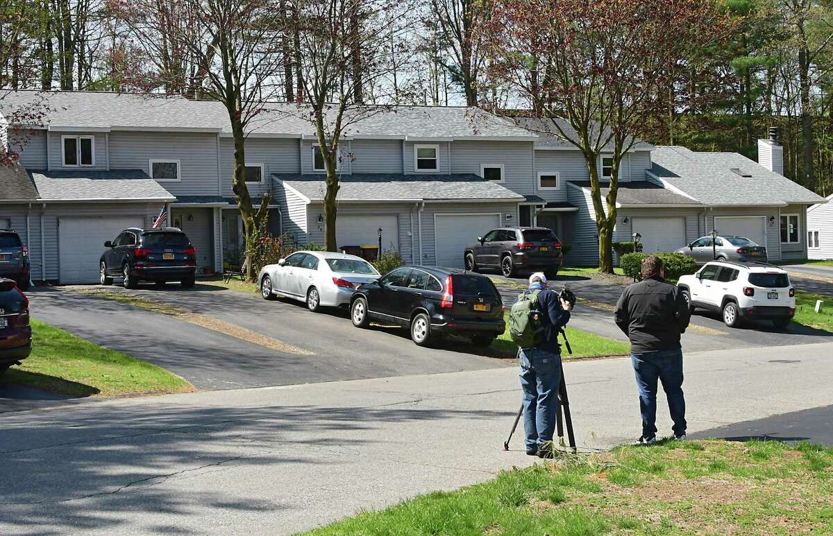 Exterior of a townhouse, at left, where a woman and state trooper were seen leaving during an investigation at Tallow Wood Drive where Gustavo Oliveira, 9, was abducted from his home on Friday, May 8, 2020 in Clifton Park, N.Y. An Amber Alert was issued after the abduction and 41-year-old Nivaldo Oliveira is the suspect. (Lori Van Buren/Times Union)