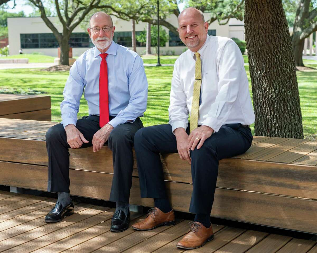 Lamar University President Ken Evans sits for a portrait with George Saltsman, director, Center for Educational Innovation and Digital Learning on the college quad. Photo made on May 1, 2020. Fran Ruchalski/The Enterprise