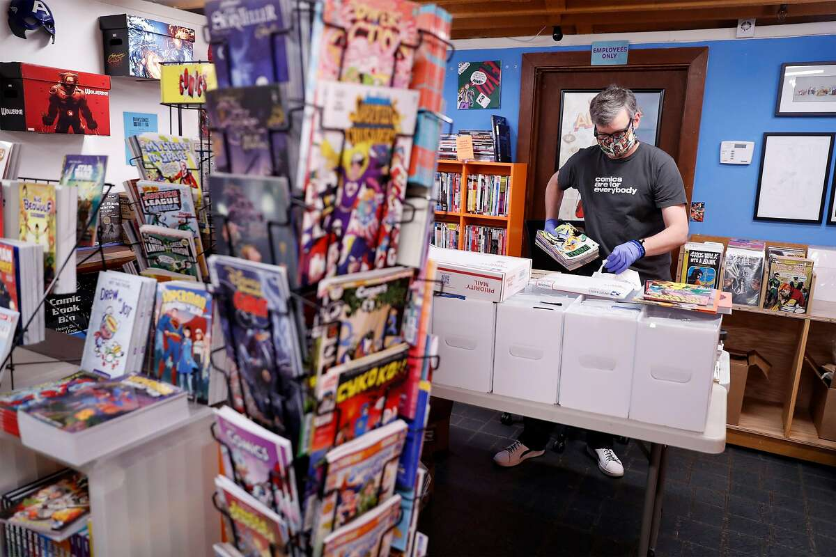 Brian Christensen, owner of Brian's Comics, packs up comics for mailing at his store in Petaluma, Calif., on Thursday, May 7, 2020. Christensen has been operating as an online only operation, but starting May 8th, Sonoma County non-essential businesses like florists, bookstores and clothing stores, will be able to offer curbside pick up.