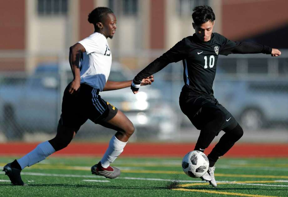 Conroe's Danny Bonilla (10) controls a pass in front of Hastings' Kenneth Opara (15) in the second period of a match during the Humble ISD soccer tournament at Atascocita High School, Saturday, Jan. 11, 2020, in Atascocita. Conroe defeated Hastings 2-1. Photo: Jason Fochtman, Houston Chronicle / Staff Photographer / Houston Chronicle © 2020