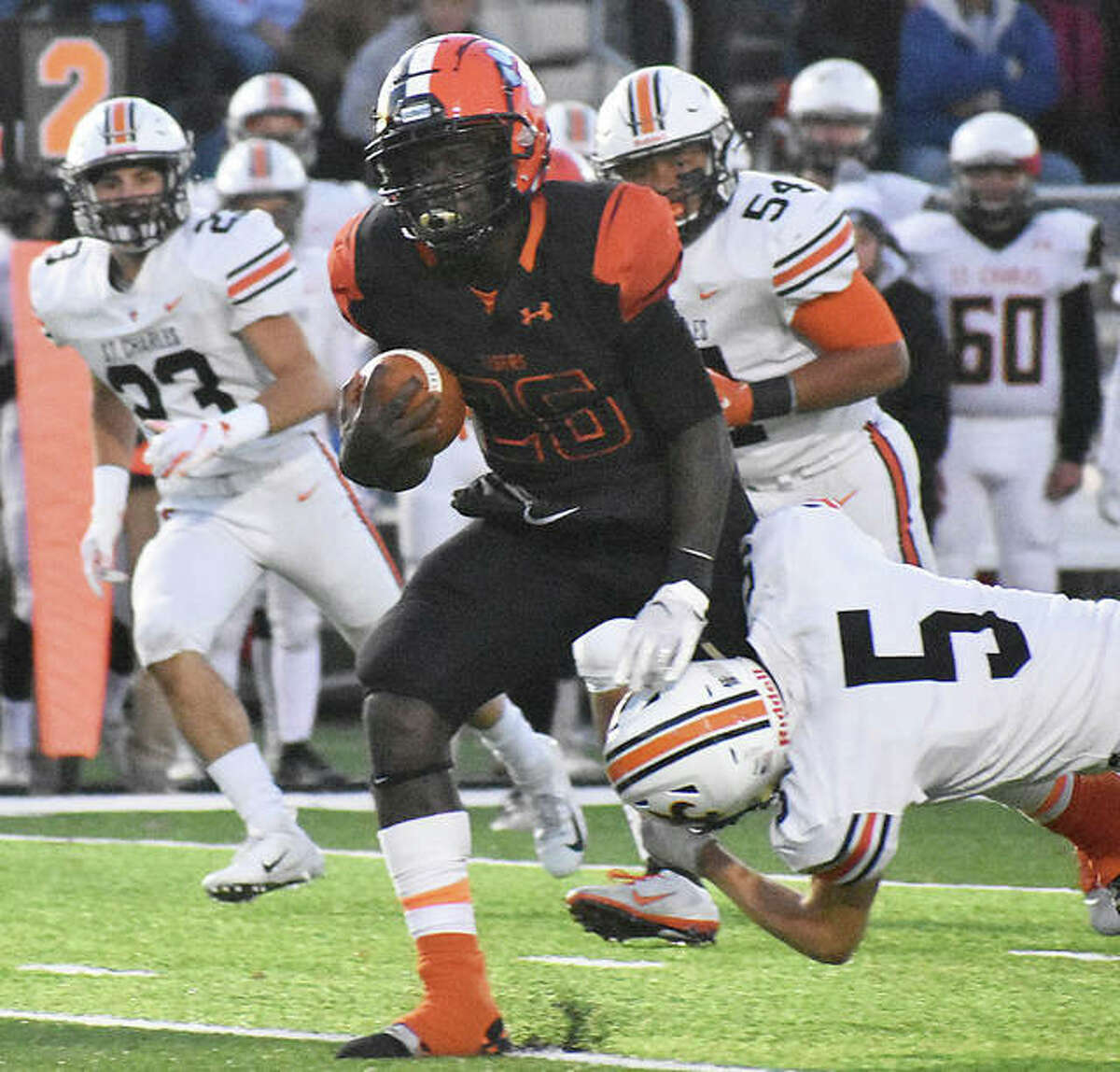 Edwardsville running back Justin Johnson Jr. breaks a tackle on his way for a touchdown in the first quarter against St. Charles East in a Class 8A first-round game inside the District 7 Sports Complex.