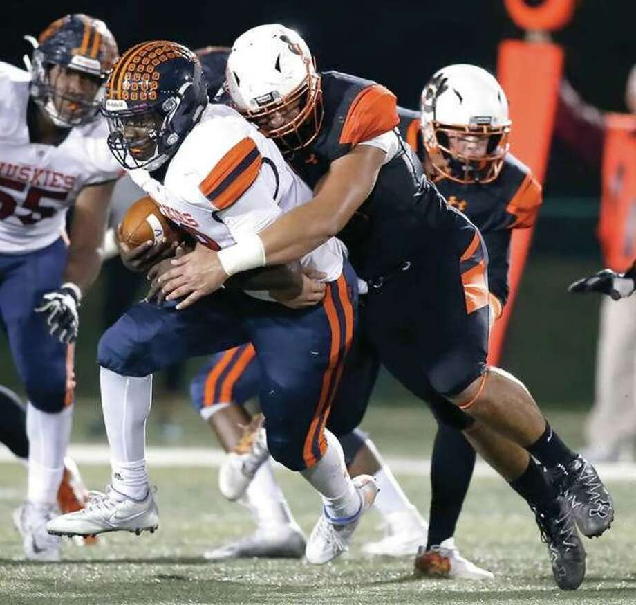 Edwardsville's AJ Epenesa sacks Oak Park-River Forest quarterback Jeremy Hunt during the Tigers' Class 8A first-round playoff victory in Edwardsville. Photo: Hearst File Photos