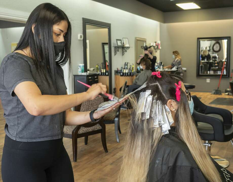 Yari Montanez, hair artist at Salon A off Neely, works on coloring Iris Reyna hair 05/08/2020 morning during a full cut and color appointment as hair salons across Texas are allowed to open. Tim Fischer/Reporter-Telegram Photo: Tim Fischer/Midland Reporter-Telegram