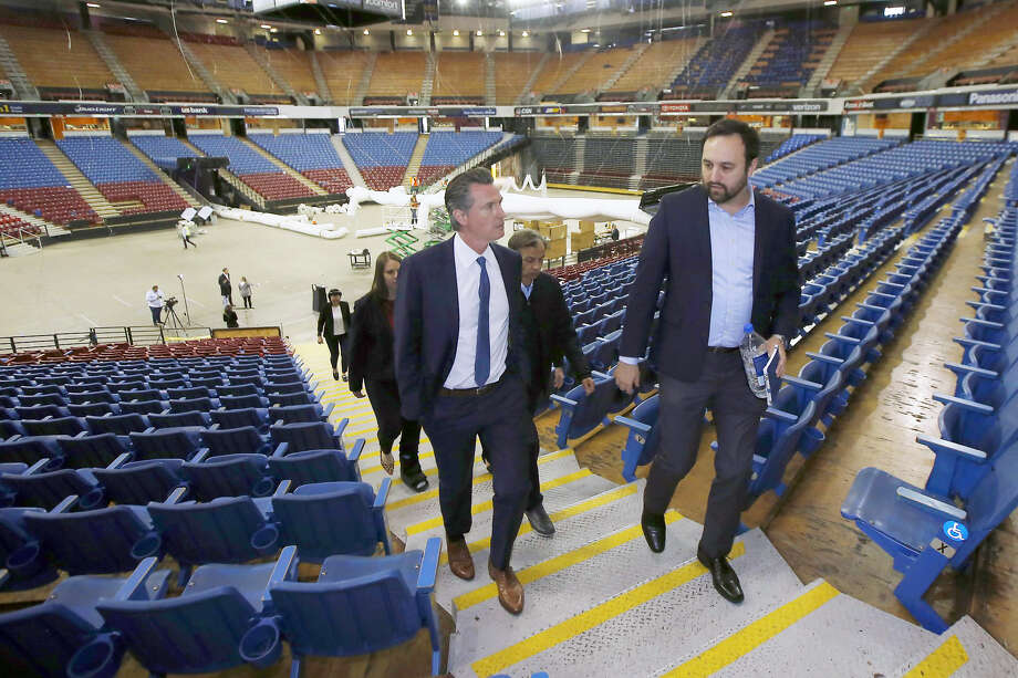 Gov. Gavin Newsom, accompanied by Jason Kenney, of the Department of General Services, tours Sleep Train Arena, the former home of the NBA's Sacramento Kings on April 6, 2020. Photo: Rich Pedroncelli / Associated Press