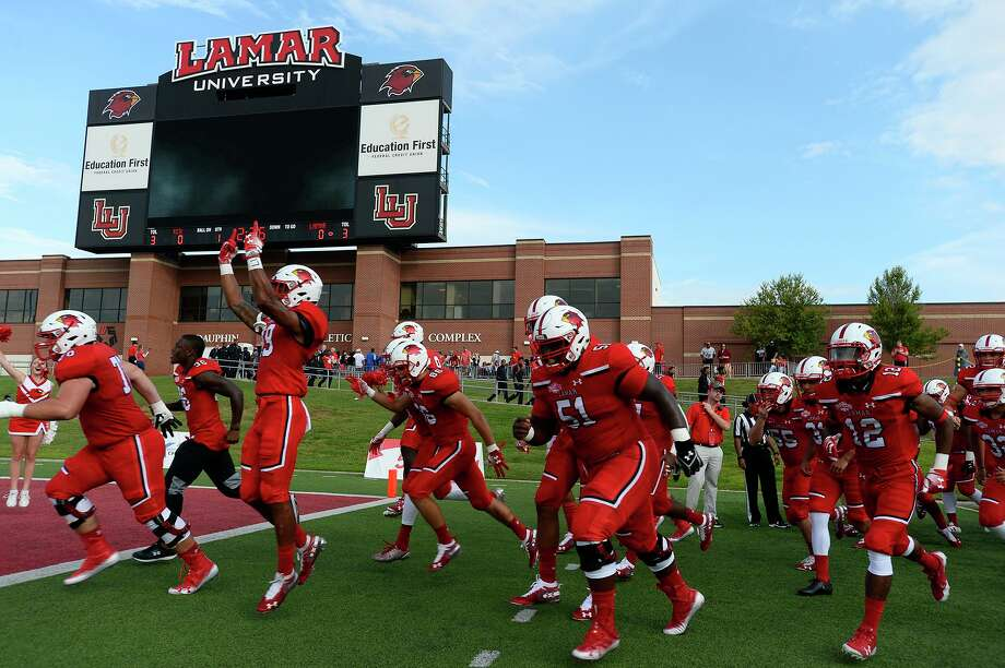 Lamar players take the field before playing against Kentucky Christian in their season opener at Provost-Umphrey Stadium. 