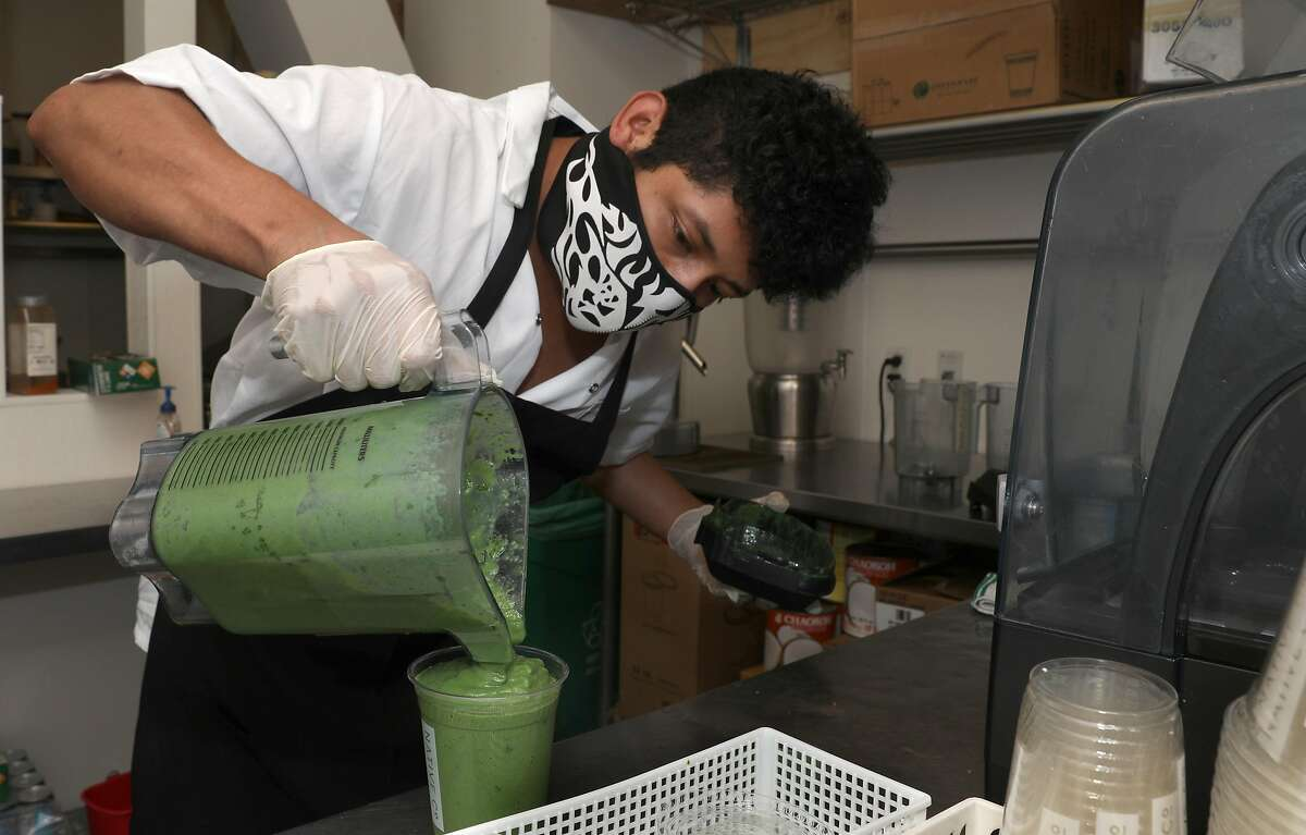 Kitchen manager Juan Lopez makes a La Sirenita smoothie at Native Co. in the financial district on Thursday, May 7, 2020, in San Francisco, Calif. Native Co. was able to secure a $181,437 forgivable loan from the federal government as it stays open for delivery.