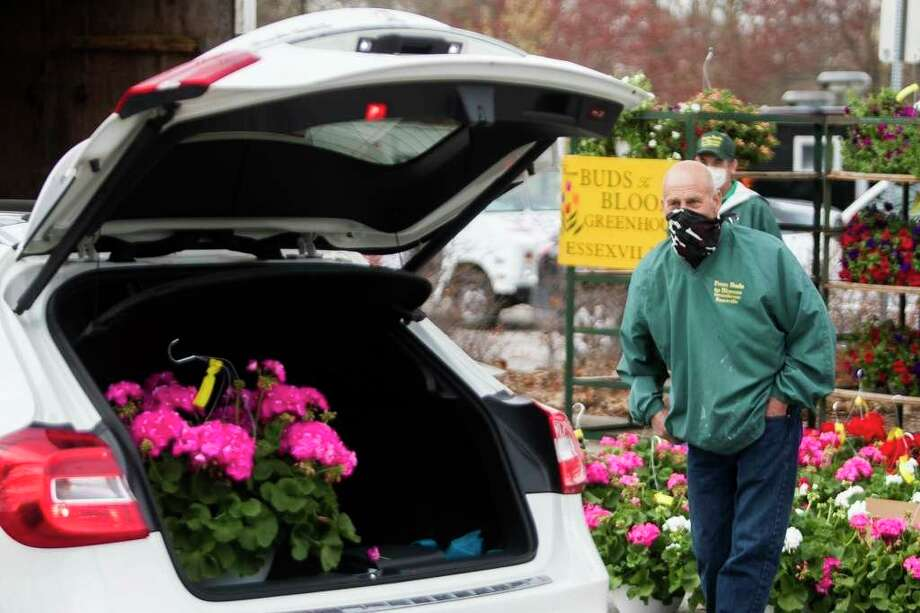 The Midland Area Farmers Market opened its season with a one-way drive-thru format Saturday, May 2, 2020. (Katy Kildee/kkildee@mdn.net)