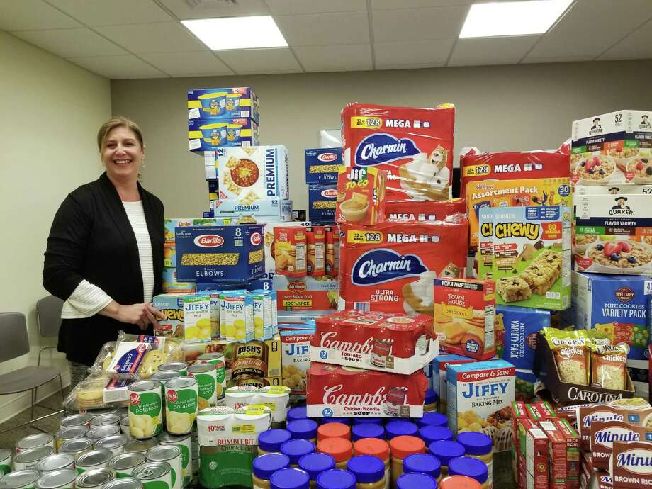 Community Health & Wellness Center of Greater Torrington CEO Joanne Borduas shows the collection of items that will be distributed May 13 in Torrington. Photo: Contributed Photo