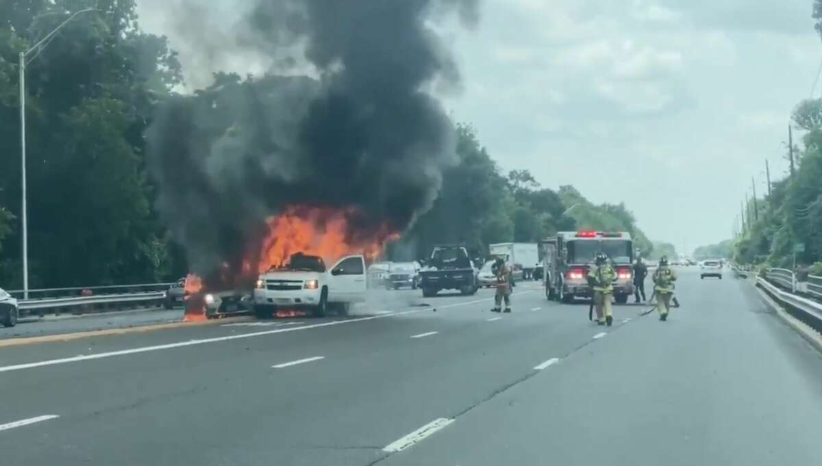 Two vehicles burst into flames after a crash along Texas Highway 6 in Houston on Friday, May 8, 2020.