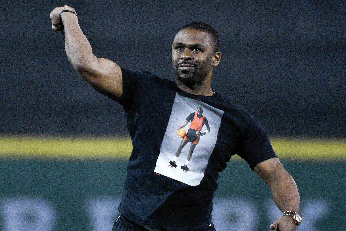 """Michael Bourn, here throwing out a first pitch before a UH baseball game in 2019, said the decision to waive the April and May rent payments for tenants in his Houston apartment complexes """"was the right thing to do"""" in the wake of economic struggles caused by the coronavirus pandemic."""