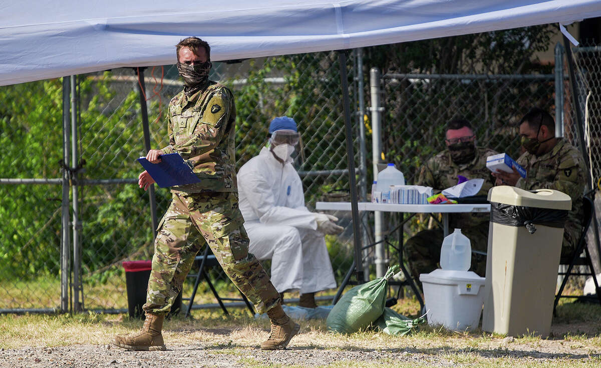 Members of the Texas Army National Guard help test residents of Rio Bravo, Texas, for the Covid-19 Coronavirus, Tuesday, May 5, 2020 outside the Webb County South Activity Center during a free state issued Covid-19 drive thru testing.