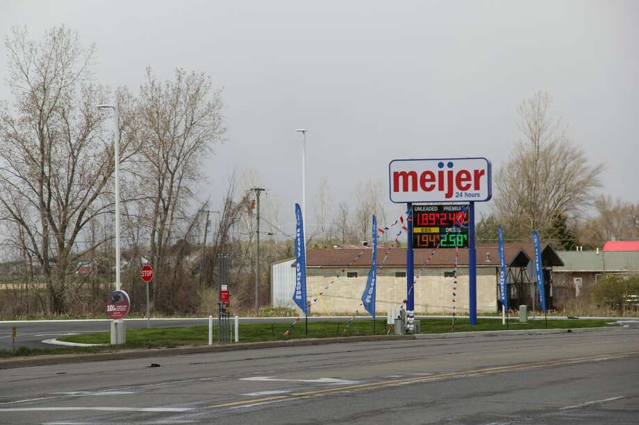 The Bad Axe Meijer gas station opened up for business this week, with cars driving up to get gas and people going inside the convenience store Photo: Robert Creenan Huron Daily Tribune