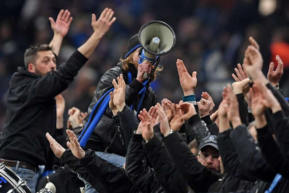 Atalanta fans cheer before the UEFA Champions League round of 16 first-leg match against Spain's Valencia. Atalanta BC won 4-1 in Milan at an event that was credited as spreading the coronavirus widely in Italy. Photo: Andrea Staccioli / LightRocket Via Getty Images