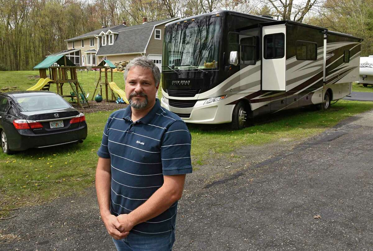 Roy Jacobsen stands in front of his RV which is parked in a relative's yard on Friday, May 8, 2020 in Valatie, N.Y. Roy and his wife Marrisa live in the RV full-time and drove it up from their winter spot in Naples, FL. They're waiting for the RV park in Rensselaer County to open up which is closed due to the Coronavirus pandemic. (Lori Van Buren/Times Union)
