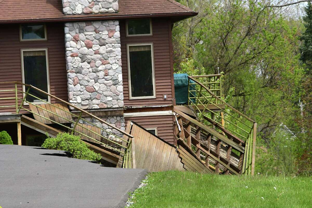 The deck on a home on Middletown Road has collapsed after another movement at a landslide on Friday, May 8, 2020 in Waterford, N.Y. (Lori Van Buren/Times Union)