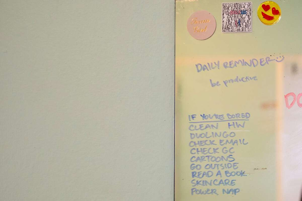 A motivational to-do list is seen written on Ligaya Chinn's mirror in her bedroom at her home in Oakland, Calif. Thursday, May 7, 2020. For the first time, high school AP tests will be administered online only in a take-home setting due to the Coronavirus pandemic and shelter-in-place order.