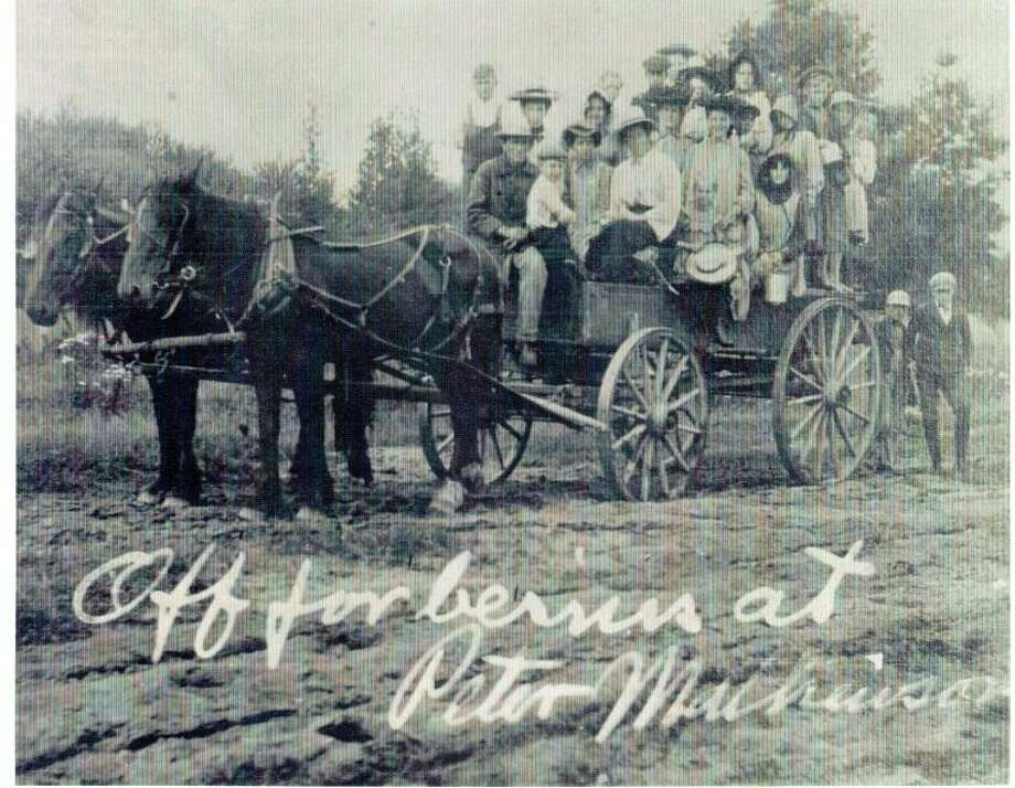 "Large wagon load of people ""off for berries at Peter Mathieson's"", whose farm was located where the Elberta Elementary School building now stands. (Courtesy Photo)"