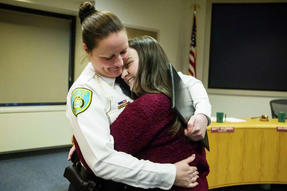 City of Midland Police Chief Nicole Ford hugs her daughter, Mackenzie Ford, 19, after a swearing-in ceremony for Ford Monday, Feb. 24, 2020 at City Hall. (Katy Kildee/kkildee@mdn.net)