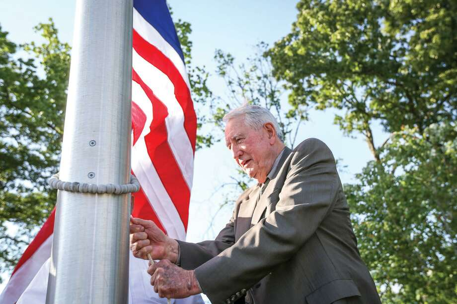 R.A. Mickey Deison raises the Flag of the Texas Navy during the annual flag raising on Tuesday, April 21, 2015, at Lone Star Monument and Flag Park in Conroe. Jim Walker and Cameron Bammel, members of Friends of the Flag, assisted in the raising. To view more photos from the event, go to HCNPics.com. Deison died on Tuesday at age 89. Photo: Michael Minasi, Photographer