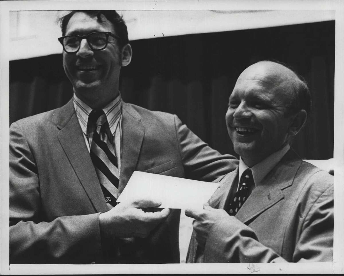A July 1971 testimonial at First Church of Albany involves Edward Mondore, president of the church Board of Trustees, with he Rev. William Cameron, right. (Times Union Archive)