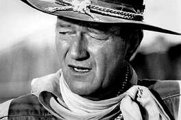 """100 best John Wayne movies Before he was one of Hollywood's most bankable and iconic Western movie stars, actor John Wayne was a USC lineman named Marion Morrison. Morrison lost his football scholarship due to a shoulder injury from a body-surfing accident, and landed a job in 1927 as a prop guy on the Fox studios lot. That gig didn't last long, however, as it took just three years for Morrison to snag his first lead role in 1930's """"The Big Trail."""" Not being fond of the name Marion Morrison, the movie's producers instructed director Raoul Walsh to change it. John Wayne was thus born. In honor of The Duke himself, StackerrankedJohn Wayne's best 100 movies. From lowest to highest, each movie is ranked according to its IMDb rating. We focuson Wayne's acting credits from his first starring role in 1930 and his breakout performance in 1939's """"Stagecoach"""" to his final star turn in 1976's """"The Shooter."""" It's worth noting that most of Wayne's films don't have too many user votes, but that's largely because they were released in the first half of the 1900s. The swaggering masculinity Wayne infused into characters bled off-screen and permeated American culture for decades with nostalgia for unencumbered male machismo. By the time Wayne appeared in John Ford's """"3 Godfathers"""" in 1948, his caricatured persona of the hardened, egoic male had firmly politicized the Western hero with shades of disgust for things like communism and liberalism. Wayne is still a hotly debated figure today. In June 2020, calls were renewed to change the name of John Wayne Airport in Orange County, California, over Wayne's 1971 interview in Playboy when he came out in favor of white supremacy, expressed no remorse over slavery or the treatment of Native Americans throughout American history, and used a homophobic slur to describe the actors in """"Midnight Cowboy."""" The controversial film star was most famous for his roles in Westerns, but also starred in war dramas, took on the role of an American boxer in"""