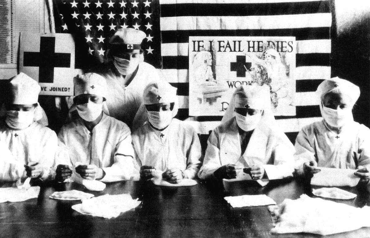 Red Cross volunteers fighting against the Spanish flu epidemic in United States in 1918.