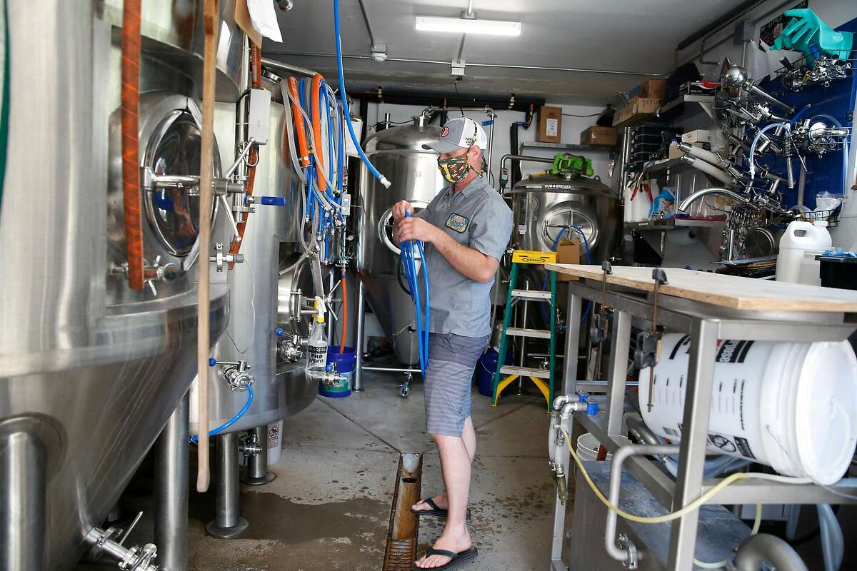 Scott Davidson sets up West Coast IPA, Mask Up, for carbonation at Ocean View Brew Works on Wednesday, May 6, 2020 in Albany, Calif.
