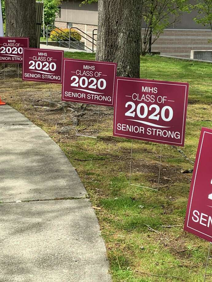 Mercer Island High School welcomes seniors as they pick up their caps and gowns on May 1, 2020. Photo courtesy of Mercer Island School District Facebook page. Photo: Mercer Island School District