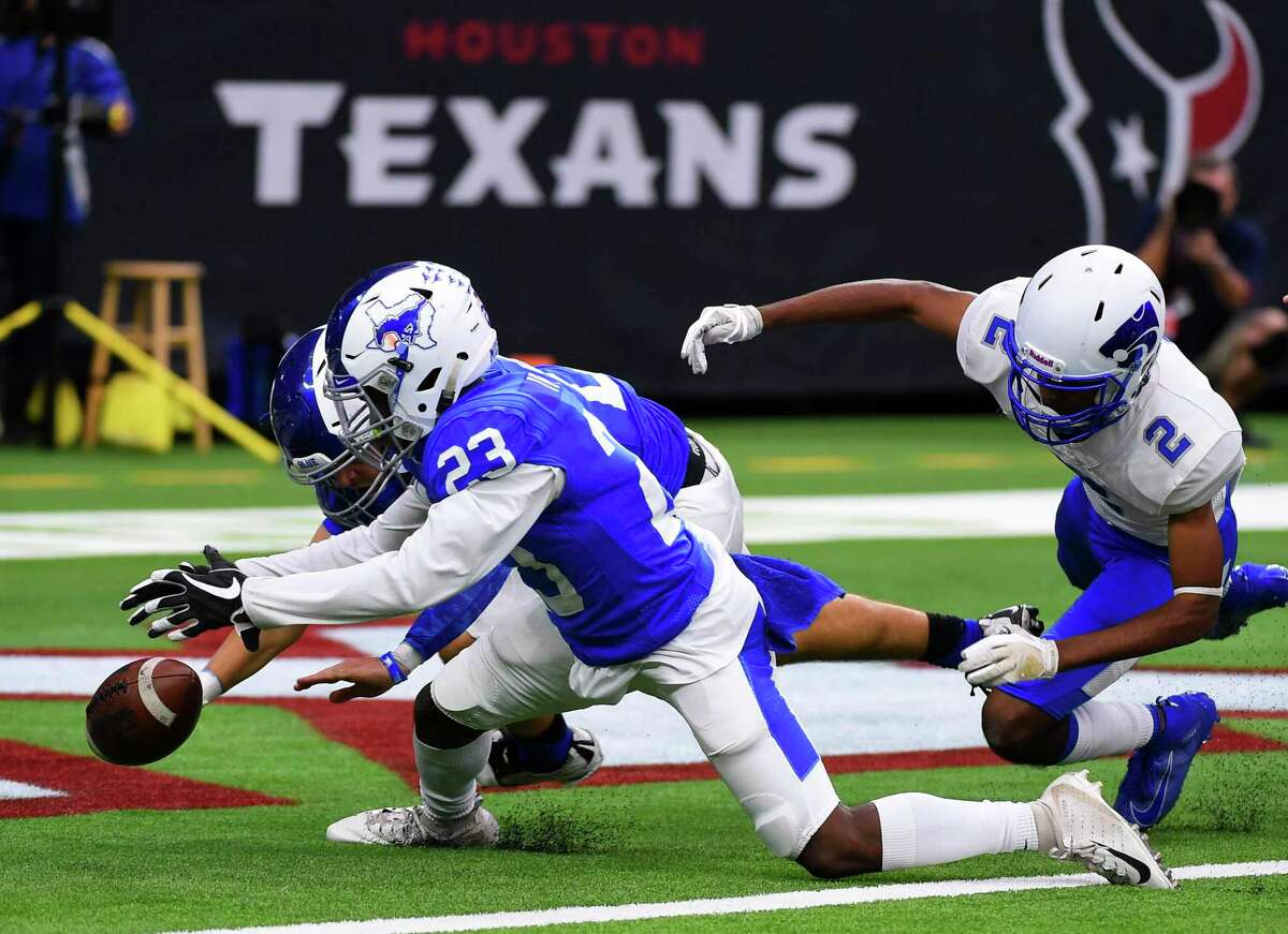 Katy Taylor's Cecil Ivey Jr. (23) recovers a kickoff fumble in the end zone for a touchdown during the first half of a 6A division II regional final high school football game against Cy Creek, Dec. 7, 2019, in Houston.