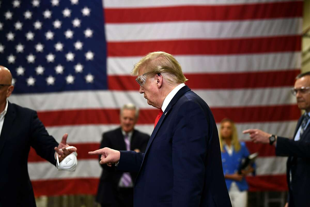 TOPSHOT - US President Donald Trump participates in a tour of a Honeywell International plant that manufactures personal protective equipment in Phoenix, Arizona on May 5, 2020. (Photo by Brendan Smialowski / AFP) (Photo by BRENDAN SMIALOWSKI/AFP via Getty Images)