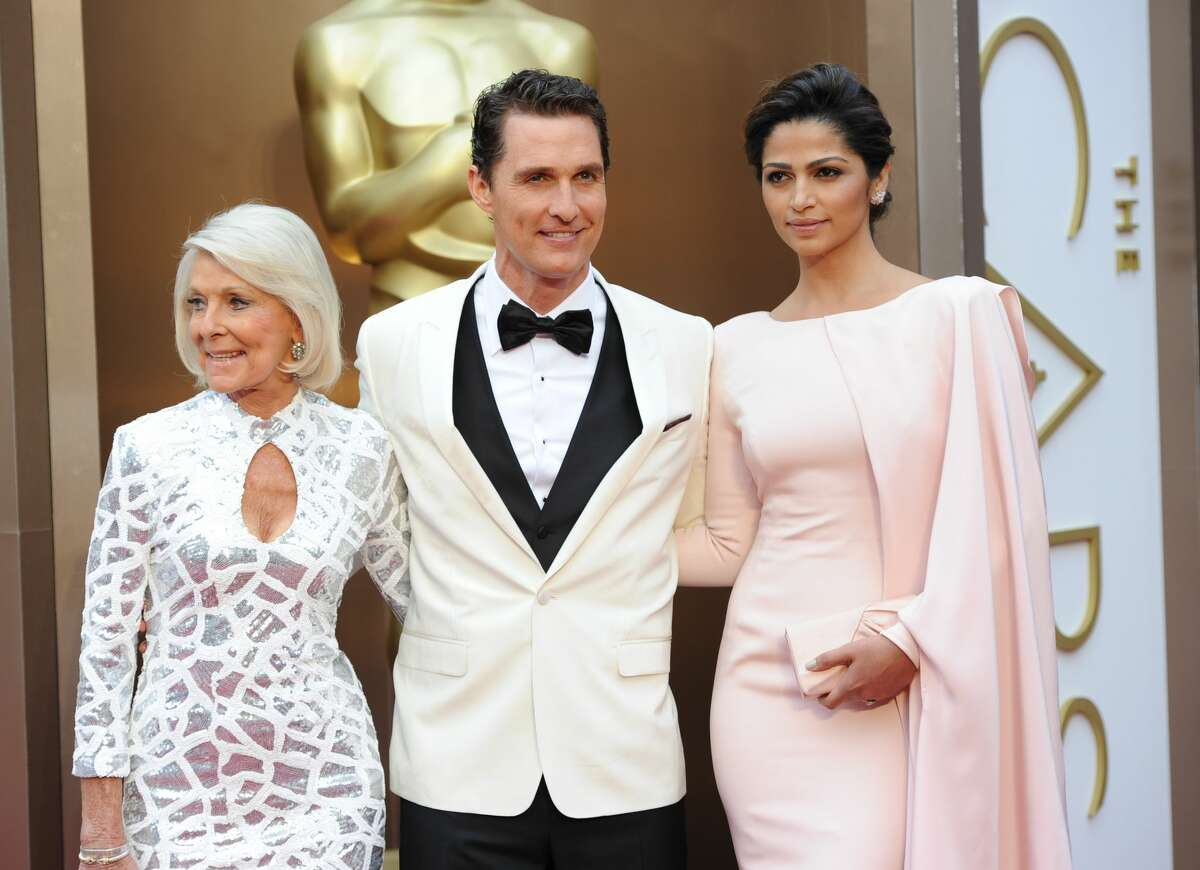 Matthew McConaughey with mother Mary Kathlene and wife Camila Alves at the 86th Academy Awards on March 2nd, 2014.