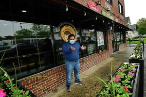 Don Carmelos restaurant owner Luis Solis speaks about social distancing patrons in his restaurant outdoor seating area Friday, May 8, 2020, in Norwalk, Conn.