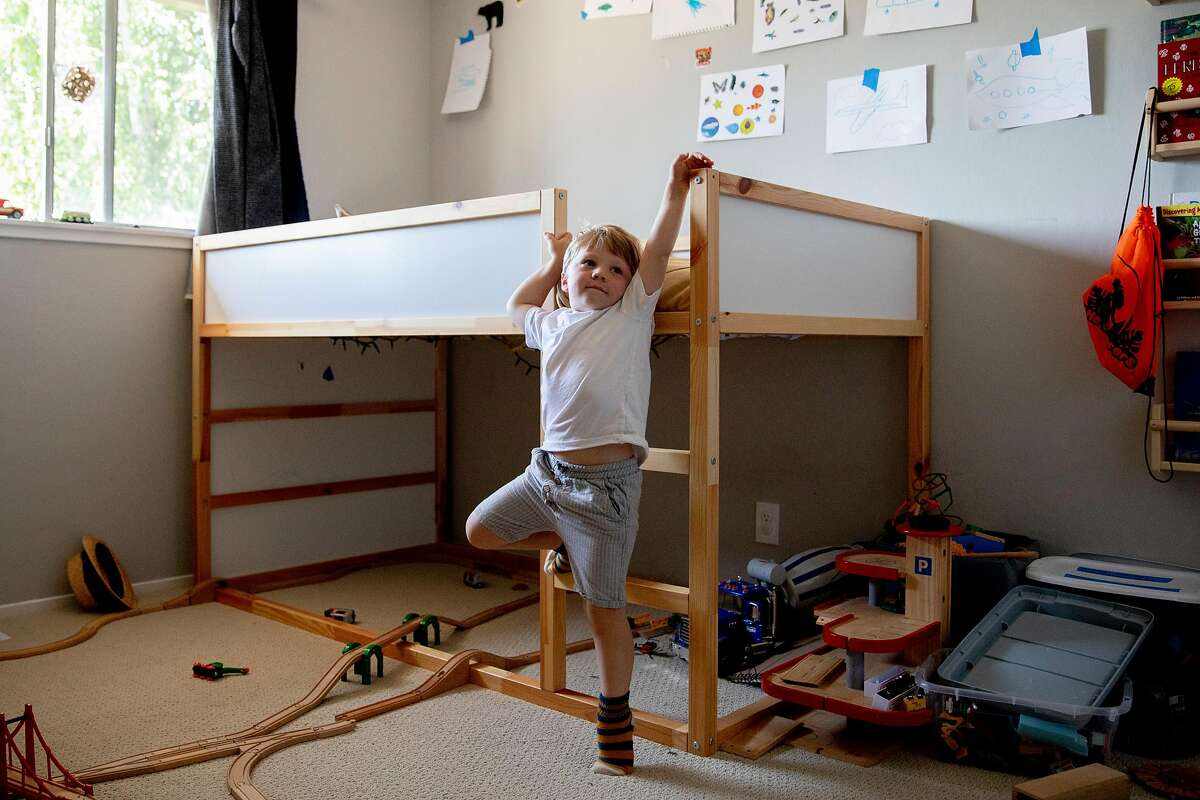 Liam Havenar-Daughton, 3, climbs up the ladder of his bunk bed in the bedroom of his home in El Sobrante, Calif. Thursday, May 7, 2020. Despite federal and state funding, hundreds of childcare facilities may shut down due to the Coronavirus pandemic, leaving parents with nowhere to leave their kids when the economy reopens and they want to return to work. The Havenar-Daughtons pay $1,900 a month for childcare they can't use during the shelter in place period, fearing that otherwise they might lose the preschool and nanny who watches their children.