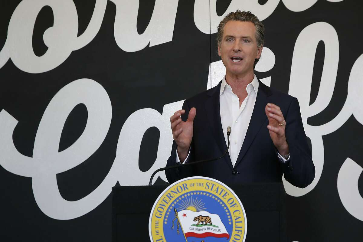 California Gov. Gavin Newsom discusses his plan for the gradual reopening of California businesses during a news conference at the Display California store in Sacramento, Calif.