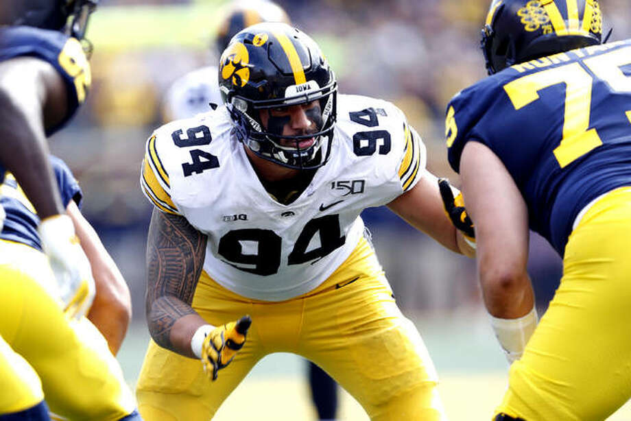 Iowa defensive end A.J. Epenesa (94) plays against Michigan last season in Ann Arbor, Mich. The Buffalo Bills, who drafted Epenesa in the second round of this year's NFL Draft, signed the Edwardsville High graduate Friday. Photo: AP Photo