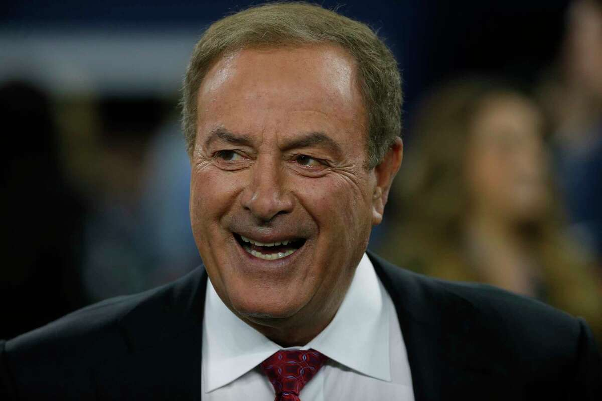 Al Michaels, play-by-play voice for NBC's Sunday Night Football, looks on from the field before the game between the Dallas Cowboys and Minnesota Vikings in an NFL football game in Arlington, Texas, Sunday, Nov. 10, 2019. (AP Photo/Ron Jenkins)