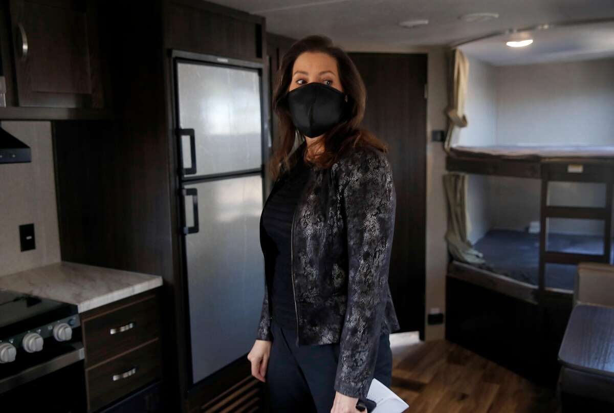 """Mayor Libby Schaaf tours a trailer home parked on an empty lot near the Coliseum in Oakland, Calif. on Tuesday, May 5, 2020. Dubbed """"Operation HomeBase"""", 67 trailers will shelter 134 homeless people who are at a significant risk if they contract the COVID-19 coronavirus"""