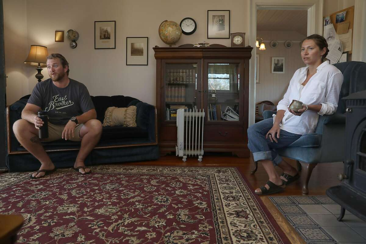 Innkeepers Tyler Waterson (left) and Tiffany Danse (right) talk about the bed and breakfast in the living room at the East Brother Light Station located on a small island just off Point San Pablo Harbor on Tuesday, July 23, 2019 in Richmond, Calif.