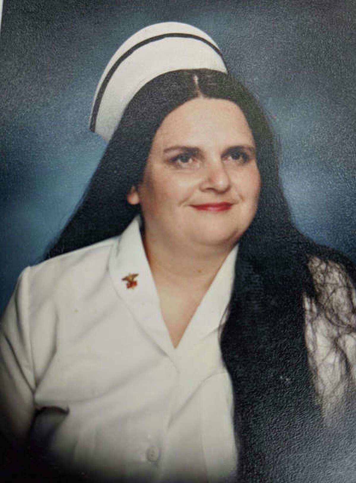 A photo of Carolyn McBride from her nursing school graduation in 1995.
