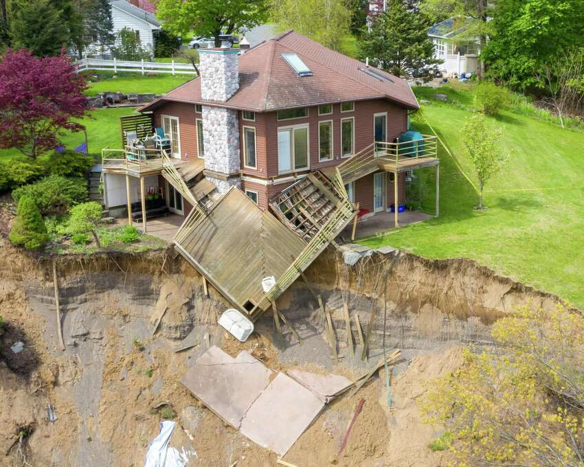 Arial view of the Middletown Road landslide on Friday, May, 8, 2020, in Waterford, N.Y. This home is on the edge of a large, sloping hill gave way on Sunday dropping about 150 feet into a pond below. (Jim Franco/Special to the Times Union)