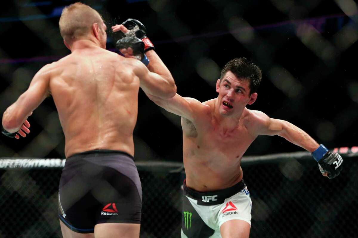 FILE - In this Jan. 17, 2016, file photo, Dominick Cruz throws a right against TJ Dillashaw in their mixed martial arts title bout at UFC Fight Night 81 n Boston. Cruz is scheduled to fight against Henry Cejudo at UFC249 in Jacksonville, Fla., on Saturday, May 9, 2020. (AP Photo/Gregory Payan, File)